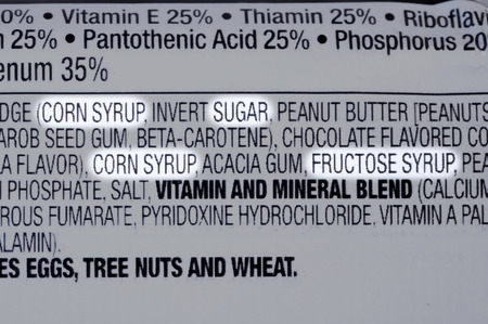 Foto per Closeup of ingredients list of granola health bar with forms of sugar highlighted - Immagine Royalty Free