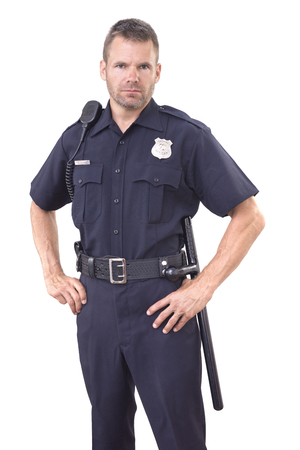 Photo pour Handsome Caucasian police officer wearing cop uniform stands with authority and bold eyes on white background - image libre de droit