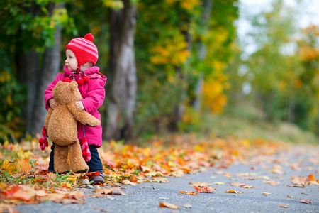 Photo for Cute 1 year old girl walking outdoors at autumn day - Royalty Free Image