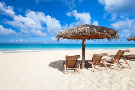 Foto de Chairs and umbrella on a beautiful tropical beach at Anguilla, Caribbean - Imagen libre de derechos