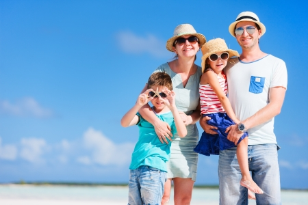 Foto de Happy beautiful family posing at beach during summer vacation - Imagen libre de derechos