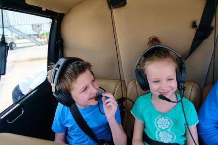 Foto de Kids at cabin of helicopter before scenic flight - Imagen libre de derechos