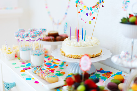 Photo for Cake, candies, marshmallows, cakepops, fruits and other sweets on dessert table at kids birthday party - Royalty Free Image