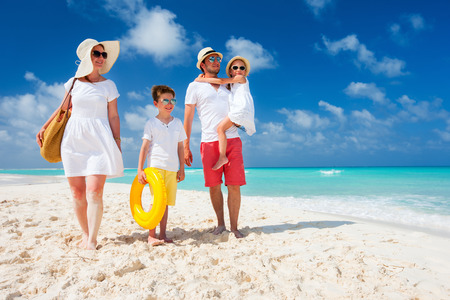 Foto de Happy beautiful family with kids on a tropical beach vacation - Imagen libre de derechos