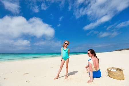 Photo for Mother and daughter enjoying tropical beach vacation - Royalty Free Image
