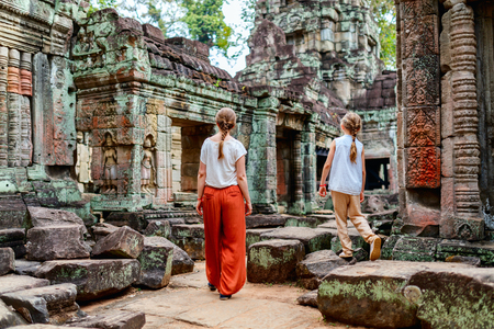 Photo for Family visiting ancient Preah Khan temple in Angkor Archeological area in Cambodia - Royalty Free Image