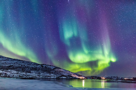 Photo pour Incredible Northern lights Aurora Borealis activity above the coast in Norway - image libre de droit