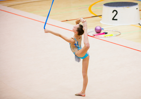 Photo for Adorable girl with rope competing in rhythmic gymnastics - Royalty Free Image
