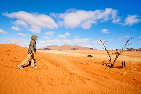 Photo for Young girl and her family exploring Namib desert during vacation in Namibia - Royalty Free Image