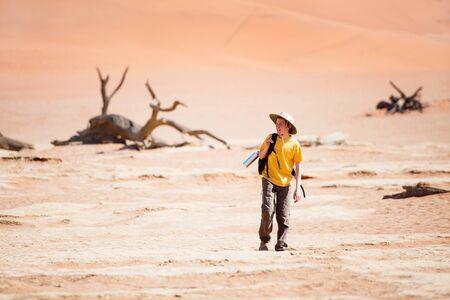 Photo for Teenage boy walking in desert in Namibia - Royalty Free Image