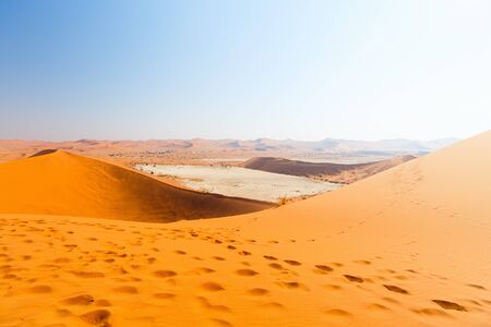 Photo for Breathtaking view of red sand dunes and white clay pan of Deadvlei Namibia - Royalty Free Image