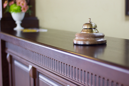 Photo pour Service bell in a hotel reception for concierge alarm on desk. - image libre de droit