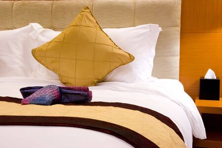 Image of a comfortable looking hotel bed.