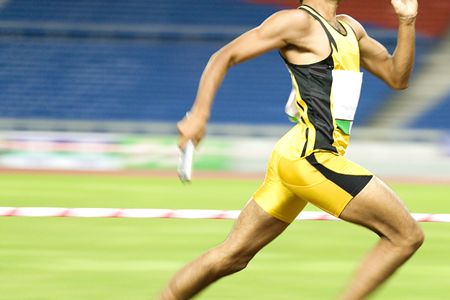 Image of a 4x400 meters athlete in action with some intentional blurring to portray speed.