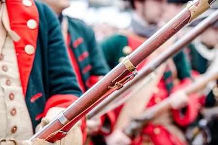 Foto de Building musketeers with guns. Focus on the gun - Imagen libre de derechos