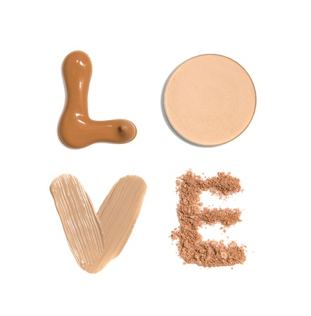 Photo pour Word Love made from samples of foundation, concealer and powder - image libre de droit