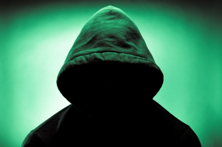 Photo pour Man wearing hood with face in shadow - image libre de droit