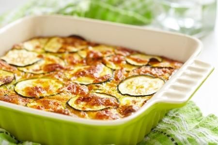 Foto de casserole with cheese and zucchini in baking dish - Imagen libre de derechos