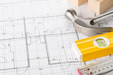 Photo pour Construction tools and wooden strips on architectural blueprint house building plan on table with copy space - image libre de droit