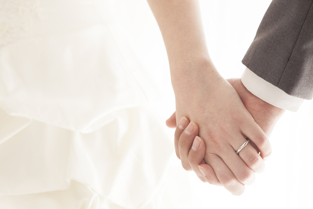Holding Hands bride and groom at a wedding