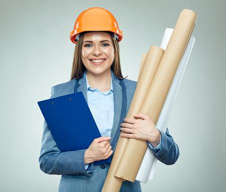 Foto de Smiling business woman holding technical drawing. Isolated portrait of real estate businesswoman . - Imagen libre de derechos