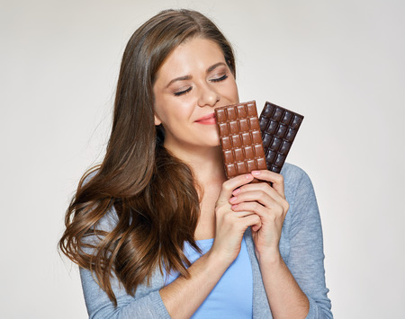 Photo for Smiling woman holding milk and dark, black chokolate. isolated portrait. - Royalty Free Image