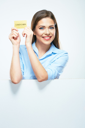 Photo pour Woman show credit card. Portrait smiling business woman with blank sign board. - image libre de droit