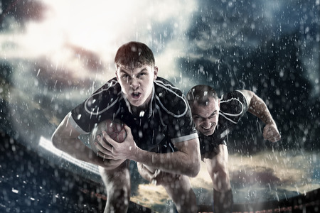 Athletes, Rugby players running in the rain around the stadium with the ball, wrestling