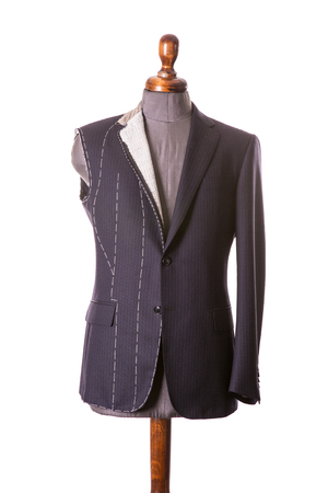 Photo pour Work in Progress Suit without sleeve on Mannequin with Exposed Stitching isolayed on white background - image libre de droit