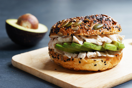 Photo for healthy burger with sliced avocado, chicken and wholegrain bread - Royalty Free Image