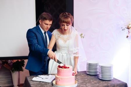 Foto de beautiful young newlywed couple in a restaurant - Imagen libre de derechos