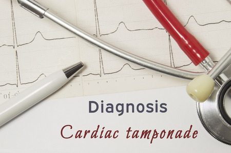 Foto de Cardiac diagnosis of Cardiac Tamponade. On doctor workplace is paper medical documentation, which indicated diagnosis of Cardiac Tamponade, surrounded by red stethoscope, ECG line and pen close-up - Imagen libre de derechos