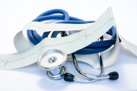 Foto de Diagnosis, treatment and prevention of diseases of heart and cardiovascular system concept photo. Blue stethoscope is surrounded by tape of ECG with electrocardiogram drawn on it. Diagnosis of disease - Imagen libre de derechos