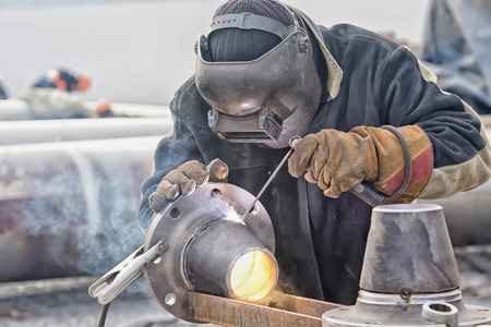 Photo pour Welding works on manufacturing of units and parts of pipelines in the field - image libre de droit