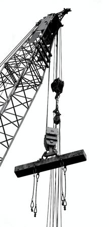 Foto de Outline silhouette of a large crane lifting a solid steel girder - Imagen libre de derechos