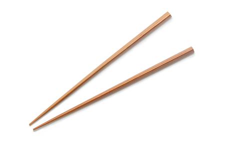 Foto de Wooden Chopsticks isolated on white background. - Imagen libre de derechos