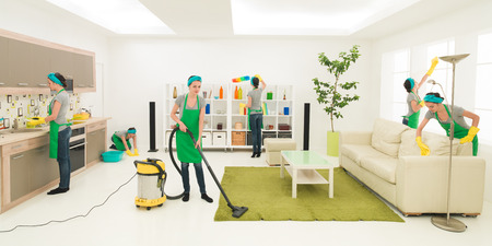 Foto de same woman cleaning living room, digital composite image - Imagen libre de derechos
