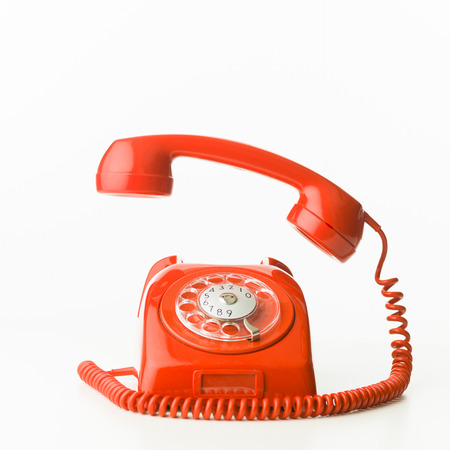 Photo pour closeup of red vintage phone ringing, isolated on white background - image libre de droit