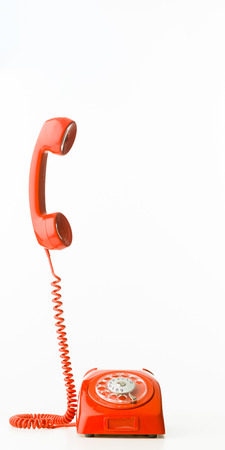 Photo pour retro styled telephone with receiver standing up, isolated on white background - image libre de droit