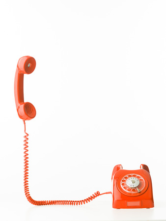 Foto de retro styled telephone with receiver standing up, isolated on white background - Imagen libre de derechos