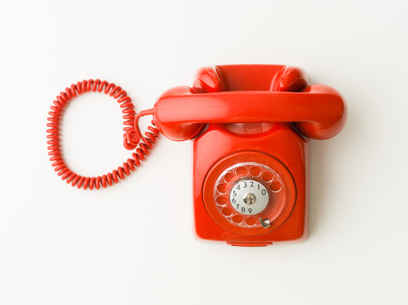 Photo pour top view of red vintage phone on white background - image libre de droit