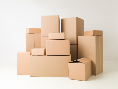 Foto de stack of cardboard boxes on white background - Imagen libre de derechos