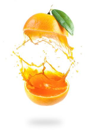 Photo for Orange juice splashing isolated on white - Royalty Free Image