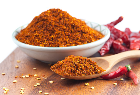 Photo for Cayenne pepper spice on wooden table - Royalty Free Image