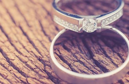Foto de wedding rings on wood,vintage color toned image - Imagen libre de derechos