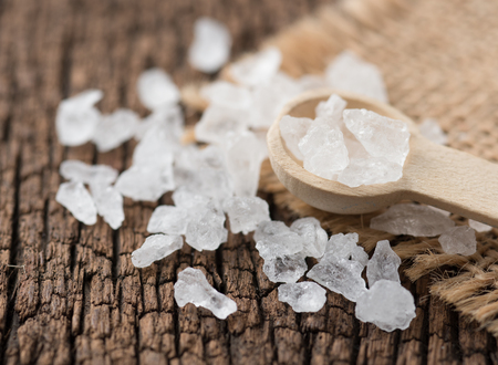 Photo for Rock sugar with spoon on wood background. - Royalty Free Image