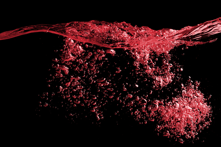 Photo for Clear splash surface of red wine or juice water with drops. Isolated on a black - Royalty Free Image