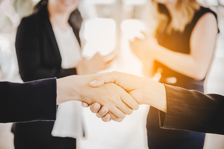 Photo for Business people shaking hands after finish reach agreement for startup new project. Negotiating and Happy working concept. Handshake gesturing connection deal concept. People and teamwork theme - Royalty Free Image