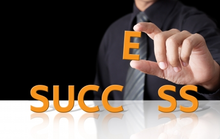 Businessman and word Success