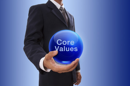 Photo for Businessman hand holding blue crystal ball with core values word. - Royalty Free Image